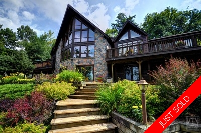 Muskoka Lake of Bays Cottage for sale: 4 bedroom 3 bathrooms, sandy beach, south west